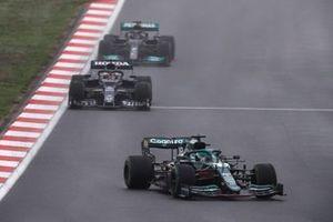 Lance Stroll, Aston Martin AMR21, Yuki Tsunoda, AlphaTauri AT02, and Lewis Hamilton, Mercedes W12