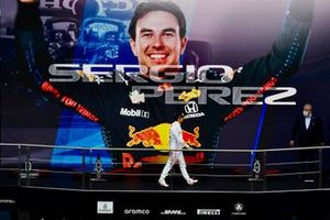 Sergio Perez, Red Bull Racing, 3rd position, arrives on the podium