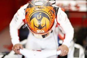 Nikita Mazepin, Haas F1, enters his cockpit