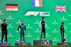 Laurent Rossi, CEO, Alpine F1, Sebastian Vettel, Aston Martin, 2nd position, Esteban Ocon, Alpine F1, 1st position, and Lewis Hamilton, Mercedes, 3rd position, on the podium