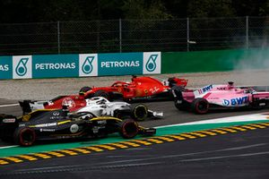 Sebastian Vettel, Ferrari SF71H lighting up his tyres after making contact with Lewis Hamilton, Mercedes AMG F1 W09 while Sergio Perez, Racing Point Force India VJM11,Charles Leclerc, Alfa Romeo Sauber C37 and Nico Hulkenberg, Renault Sport F1 Team R.S. 18 drive past