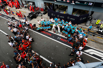 Lewis Hamilton, Mercedes AMG F1, first position, Valtteri Bottas, Mercedes AMG F1, third position, and the Mercedes team celebrate as photographers gather for a shot