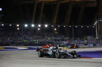 Lewis Hamilton, Mercedes AMG F1 W09 EQ Power+, leads Sebastian Vettel, Ferrari SF71H, and Max Verstappen, Red Bull Racing RB14