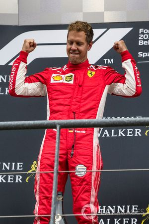 Race winner Sebastian Vettel, Ferrari celebrates on the podium