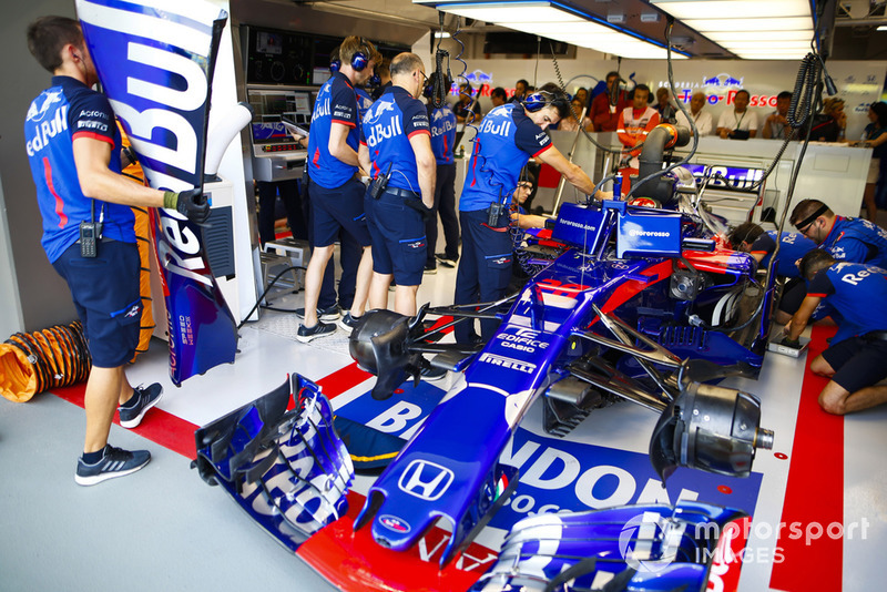 The Brendon Hartley Toro Rosso STR13 is worked on in the team's garage