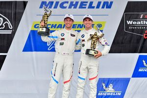 #25 BMW Team RLL BMW M8, GTLM - Alexander Sims, Connor de Phillippi celebrate the win on the podium