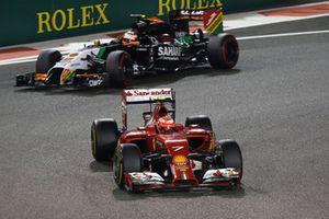 Kimi Raikkonen, Ferrari F14 T leads Nico Hulkenberg, Force India VJM07
