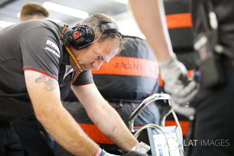 A Haas F1 engineer at work in the garage