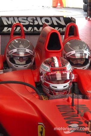 Charles Leclerc, Scuderia Ferrari, sulla Ferrari F1 3-Seater, con Franco Nugnes, Direttore di Motorsport.com Italia e Guido Meda, Direttore di Sky Motori