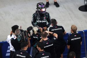 Pole man Lewis Hamilton, Mercedes-AMG F1, celebrates on arrival in Parc Ferme with his team