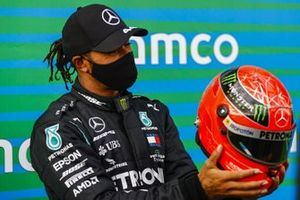 Lewis Hamilton, Mercedes-AMG F1, 1st position, with the helmet of Michael Schumacher that was gifted to him to commemorate the equal race win record of 91