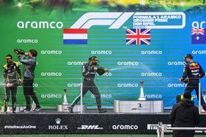 Daniel Ricciardo, Renault F1, 3rd position, Lewis Hamilton, Mercedes-AMG F1, 1st position, and Max Verstappen, Red Bull Racing, 2nd position, celebrate on the podium