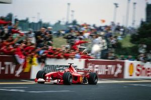 Michael Schumacher, Ferrari F1-2000, crosses the line for victory in the race and the drivers' world championship
