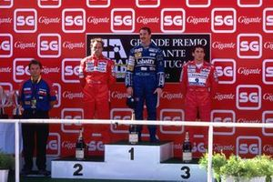 Podium: second place Gerhard Berger, Ferrari, Race winner Nigel Mansell, Williams, thrid place Ayrton Senna, McLaren