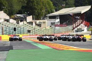 Nicholas Latifi, Williams FW43, runs wide as Kevin Magnussen, Haas VF-20, Romain Grosjean, Haas VF-20, and Kimi Raikkonen, Alfa Romeo Racing C39, chase the pack at the start