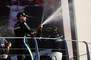 Valtteri Bottas, Mercedes-AMG F1, 2nd position, sprays Champagne from the podium