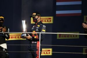 Alex Albon, Red Bull Racing, on the podium with his trophy