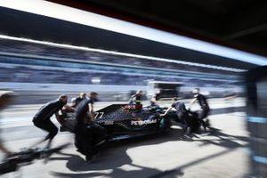 Valtteri Bottas, Mercedes F1 W11, is returned to the garage by mechanics
