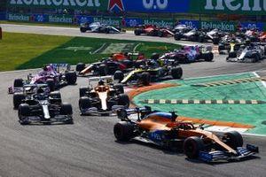 Carlos Sainz Jr., McLaren MCL35 Valtteri Bottas, Mercedes F1 W11 and Lando Norris, McLaren MCL35