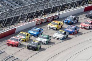 Denny Hamlin, Joe Gibbs Racing, Toyota Supra SportClips leads the field to a restart