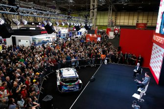 The crowd watches as Lando Norris, McLaren is interviewed on the Autosport stage
