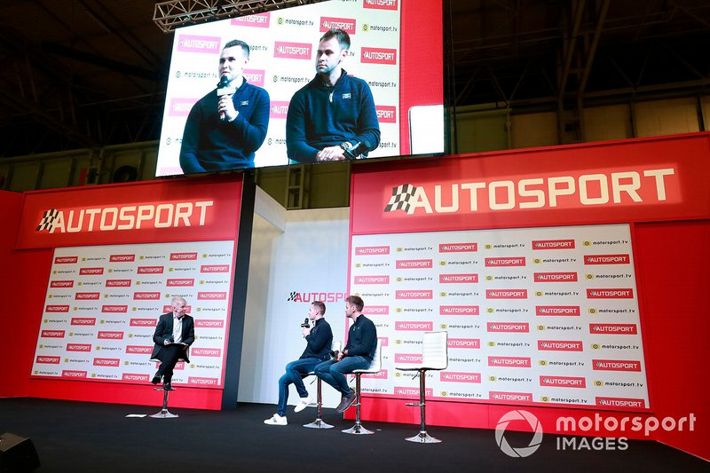 Presenter Alan Hyde talks to Jonny Adam and Charlie Eastwood on the Autosport stage