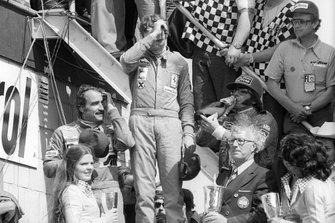 Podium: second place Clay Regazzoni, Ferrari, Race winner Niki Lauda, Ferrari, third place Emerson Fittipaldi, McLaren