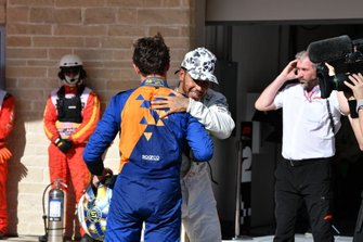 Lando Norris, McLaren, congratulates Lewis Hamilton, Mercedes AMG F1, 2nd position, on securing his sixth world drivers title