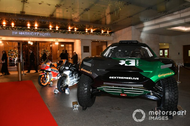 Moto GP and Rally Raid cars on display outside the venue