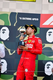 Sebastian Vettel, Ferrari, 2nd position, kisses his trophy