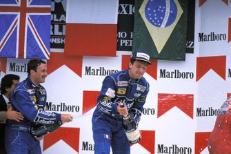 Podium: race winner Riccardo Patrese, Williams, Nigel Mansell, Williams spray champagne