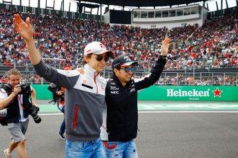 Esteban Gutierrez, Haas F1 Team and Sergio Perez, Force India