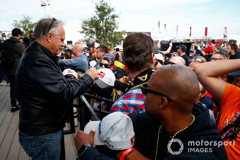Gene Haas, Owner and Founder, Haas F1 Team, signs autographs for fans