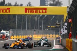 Lando Norris, McLaren MCL34, leads Valtteri Bottas, Mercedes AMG W10