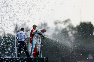 Race winner Lewis Hamilton, Mercedes AMG F1 and Sebastian Vettel, Ferrari celebrate on the podium with the champagne