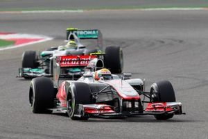 Lewis Hamilton, McLaren MP4-27 Mercedes, leads Nico Rosberg, Mercedes F1 W03