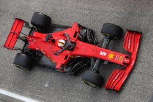Sebastian Vettel, Ferrari SF1000, heads for the grid