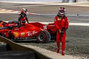 Max Verstappen, Red Bull Racing, and Charles Leclerc, Ferrari, walk away after retiring