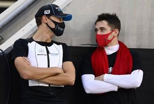 George Russell, Williams Racing, talks with Charles Leclerc, Ferrari, on the grid