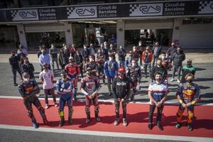 Riders observe a minute of silence in honour of the Italian legend Fausto Gresini
