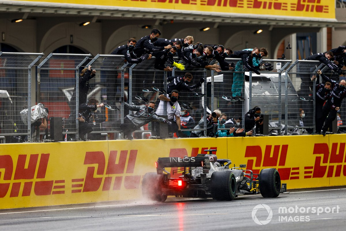 Lewis Hamilton, Mercedes F1 W11, 1st position, takes victory to secure his seventh drivers title as the Mercedes team cheer from the pit wall