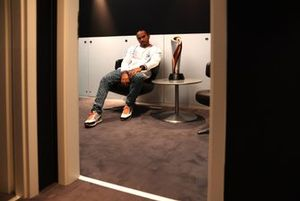 Lewis Hamilton, Mercedes-AMG F1, with his winners trophy in the drivers room after the race