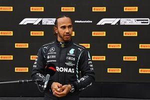 Lewis Hamilton, Mercedes, talks to the press in Parc Ferme