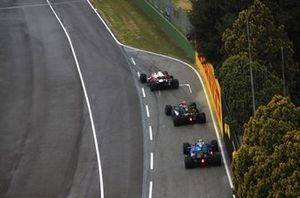 Kimi Raikkonen, Alfa Romeo Racing C41, Valtteri Bottas, Mercedes W12, and Esteban Ocon, Alpine A521, to the grid