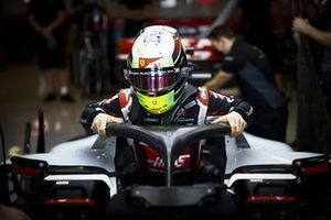 Mick Schumacher, Haas VF-20, gets into the car