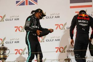Lewis Hamilton, Mercedes-AMG F1, 1st position, and Alex Albon, Red Bull Racing, 3rd position, celebrate on the podium