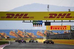 Alex Albon, Red Bull Racing RB16, Sergio Perez, Racing Point RP20, Kimi Raikkonen, Alfa Romeo Racing C39, and Daniil Kvyat, AlphaTauri AT01, line up to practice their race start procedures at the end of the session