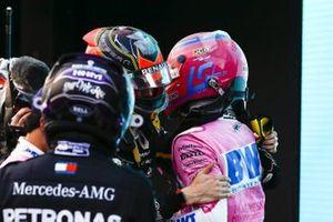 Pole man Lance Stroll, Racing Point, is congratulated by Esteban Ocon, Renault F1