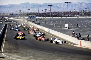 Alan Jones, Williams FW07D Ford, leads Gilles Villeneuve, Ferrari 126CK, Alain Prost, Renault RE30, Carlos Reutemann, Williams FW07C Ford, Nelson Piquet, Brabham BT49C Ford, Bruno Giacomelli, Alfa Romeo 179C, and John Watson, McLaren MP4-1 Ford