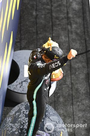 Lewis Hamilton, Mercedes-AMG F1, 1st position, celebrates on the podium with his trophy